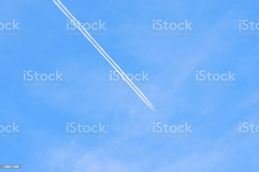 contrails of aircraft against a blue sky. routes in airways stock photo