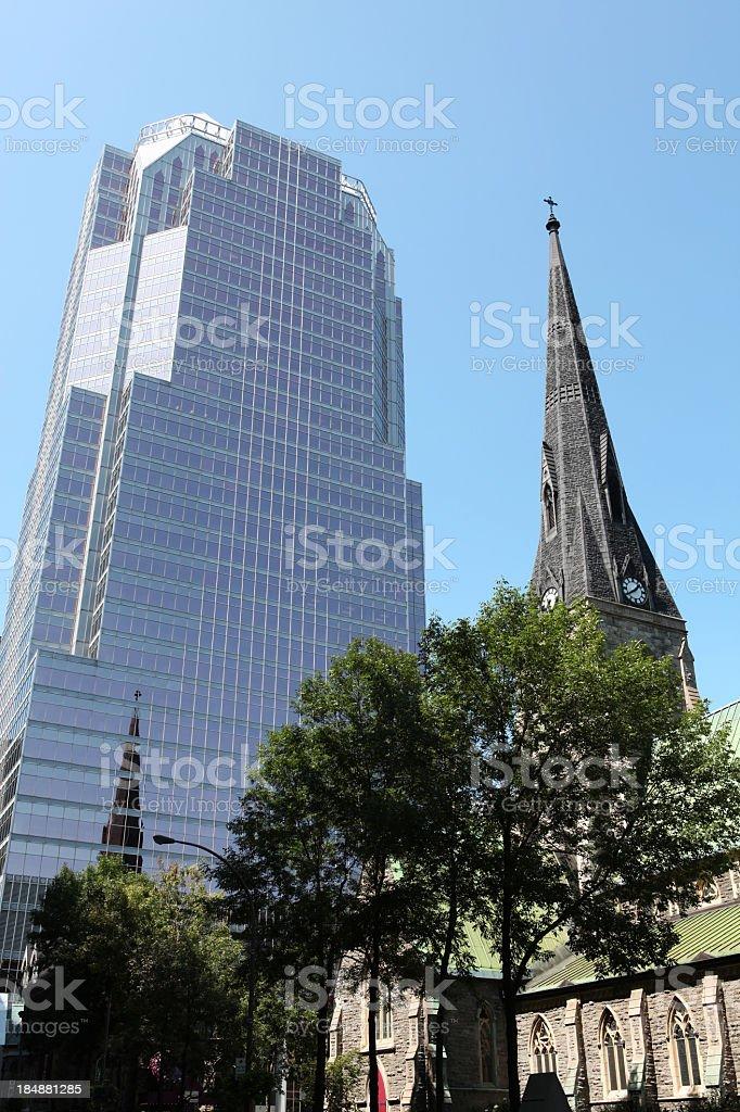 Contrast between Church and skyscraper stock photo