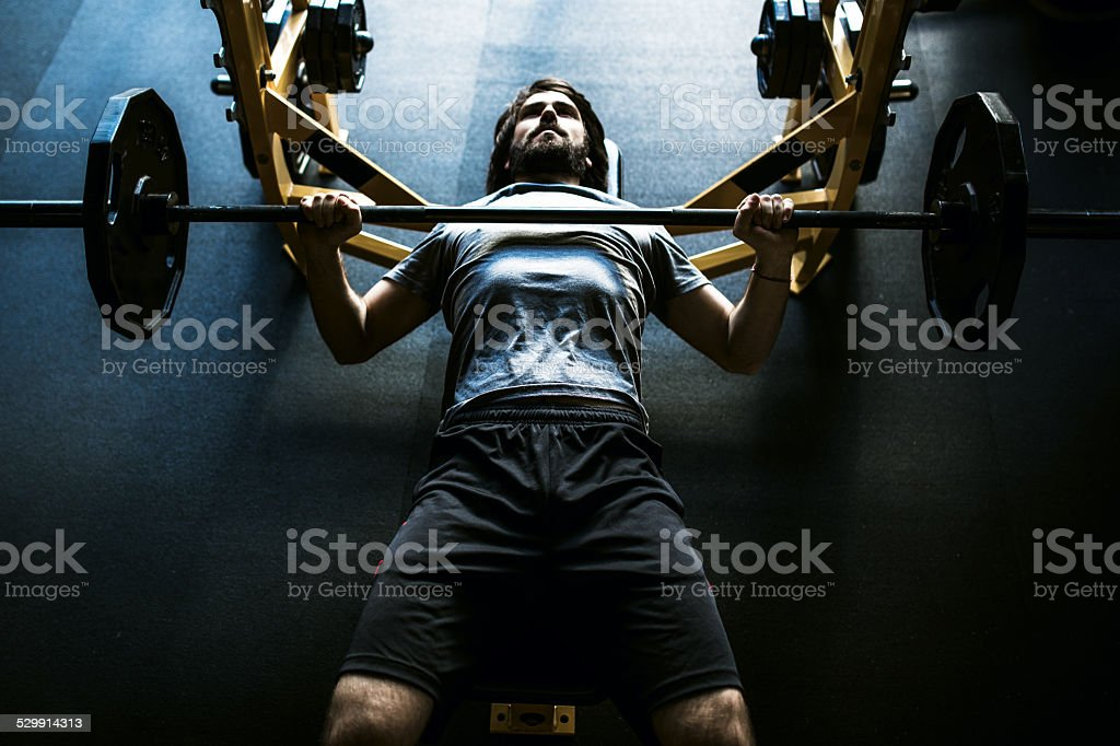Contrast Man on Bench Press stock photo