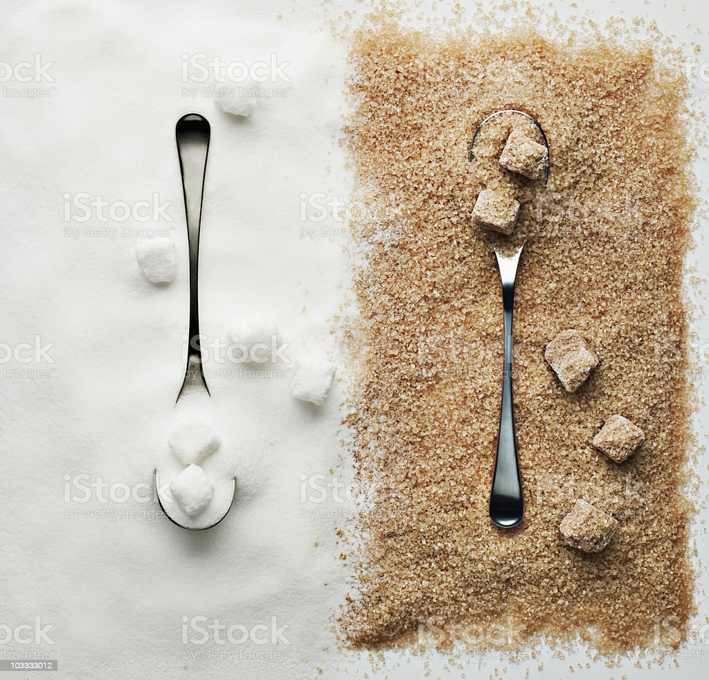 Contrasting sugar, turbinado sugar and sugar cubes with spoons stock photo