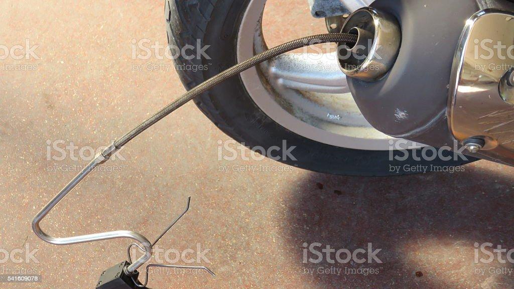Control of motorcycle exhaust stock photo