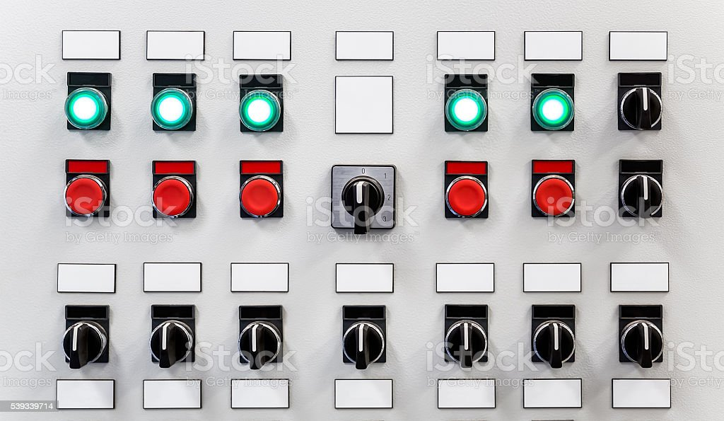Control panel of industrial equipment with switches and buttons stock photo