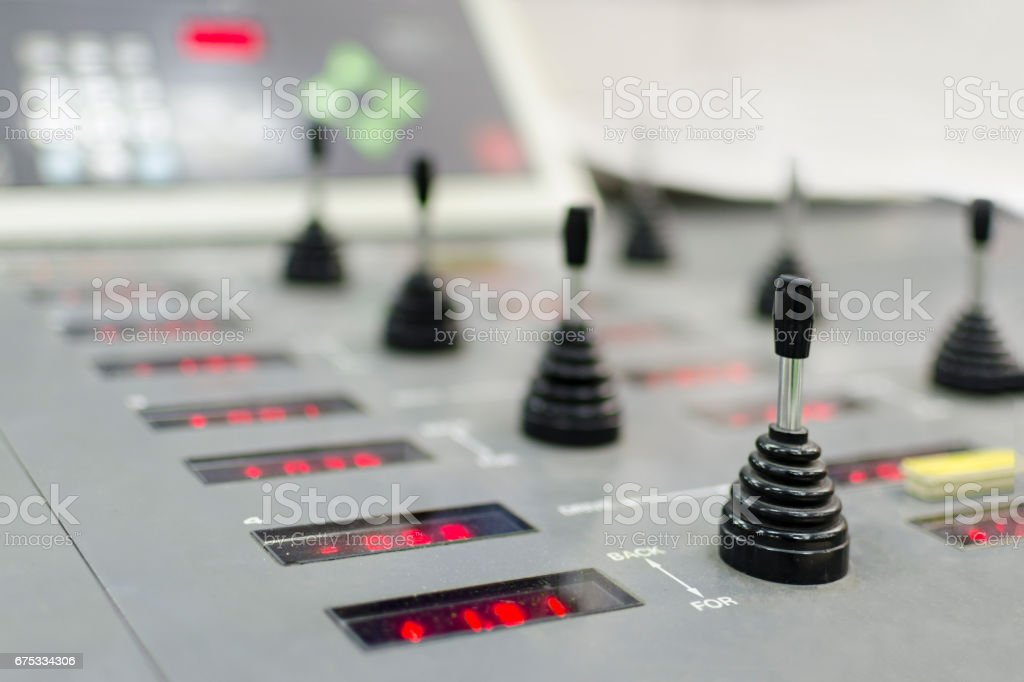 Control panel of the equipment in a modern offset printing house. Registration unit joystick digital controler, selective focus stock photo