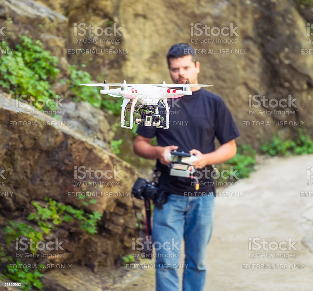 Controlling a DJI Phantom quadcopter drone stock photo