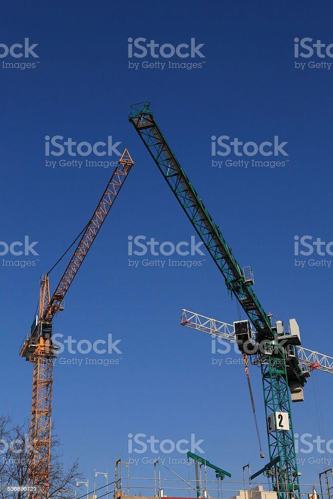 contruction cranes and blue sky stock photo