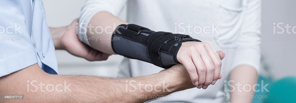 Contused hand in stabilizer stock photo