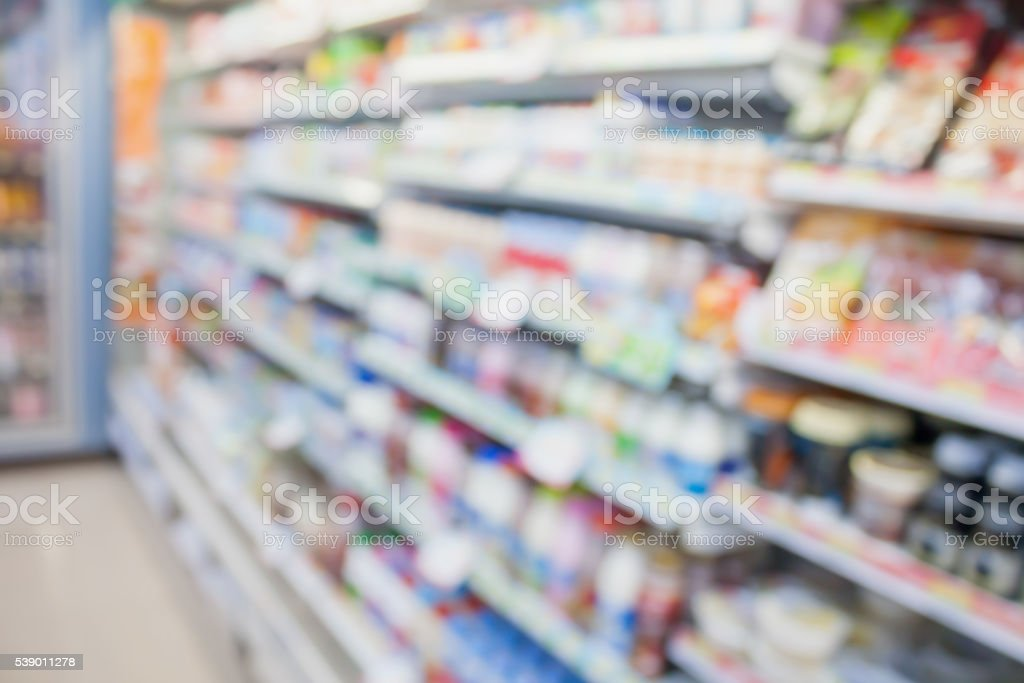 convenience store shelves blurred background stock photo