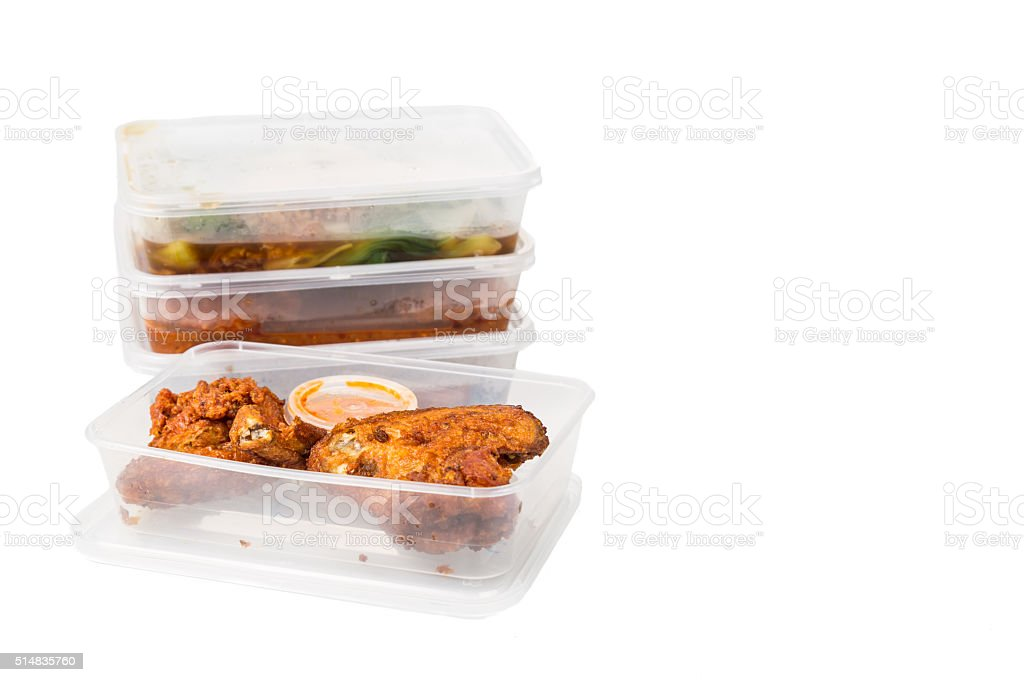 Convenient but unhealthy disposable plastic lunch boxes with mea stock photo