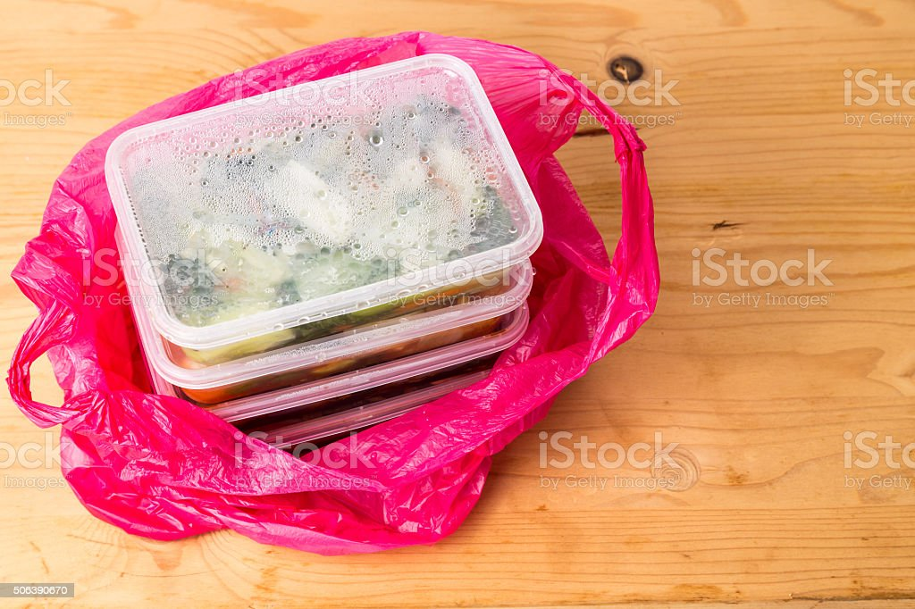 Convenient but unhealthy disposable plastic lunch boxes with meal stock photo