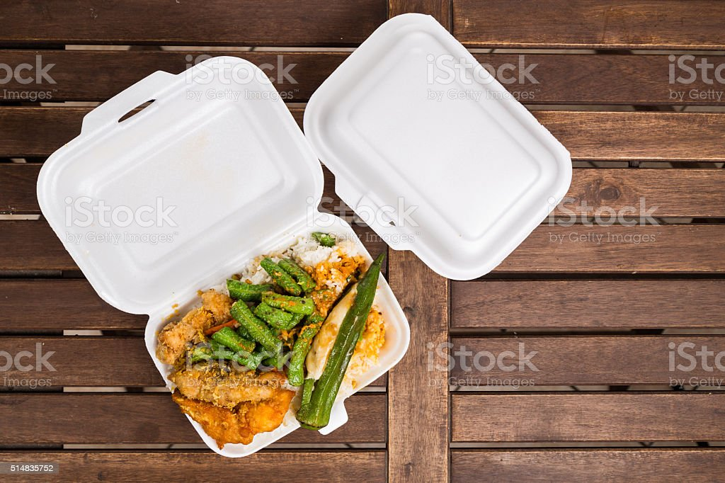 Convenient but unhealthy polystyrene lunch boxes with take away stock photo
