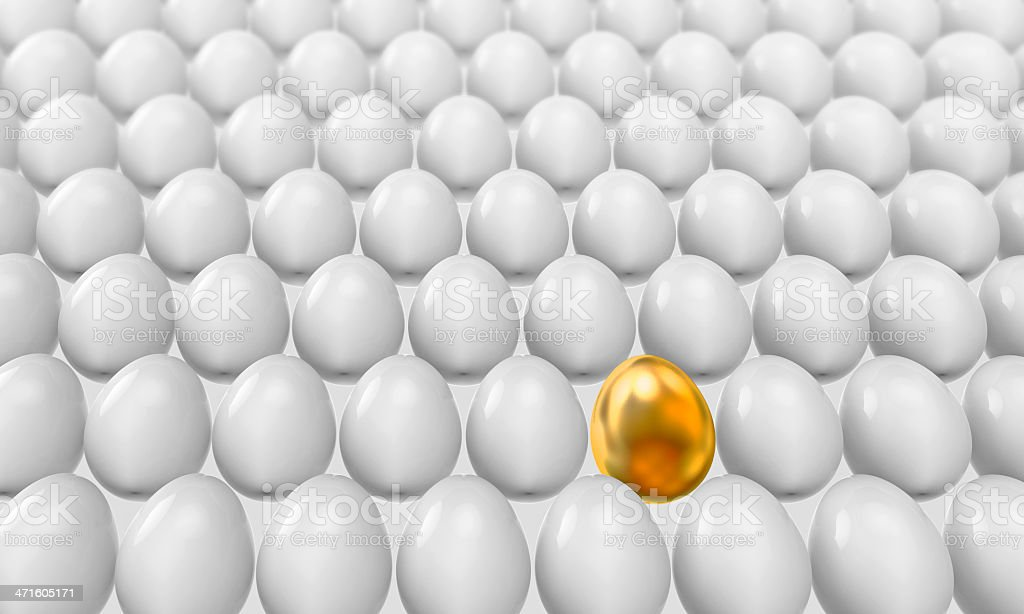 Conventional eggs and one golden royalty-free stock photo