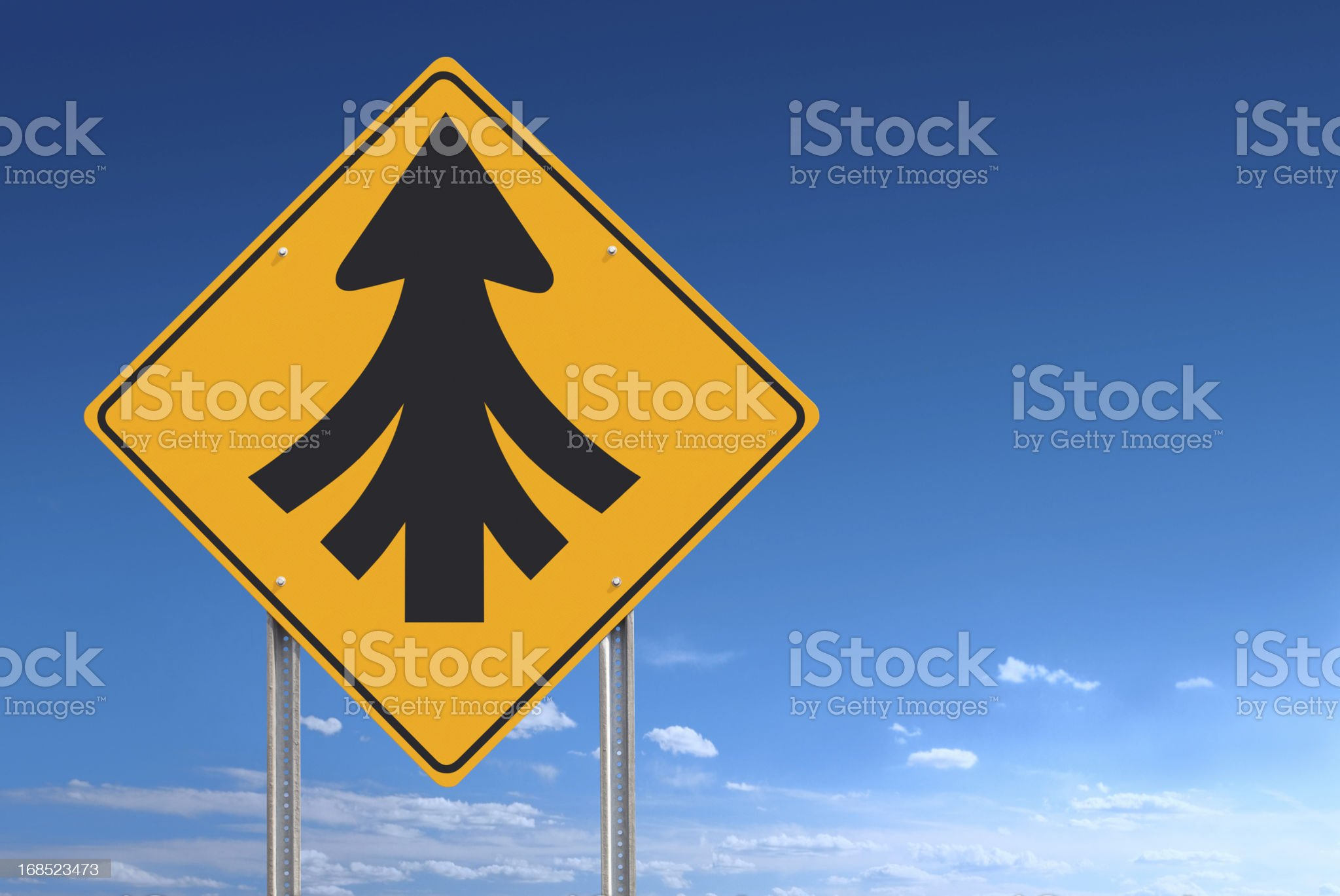 Convergence Ahead Merging Into Unity Road Sign on Sky Background royalty-free stock photo
