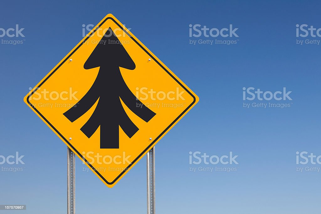 Convergence or Multiple Merges Ahead Traffic Sign Post Over Sky stock photo
