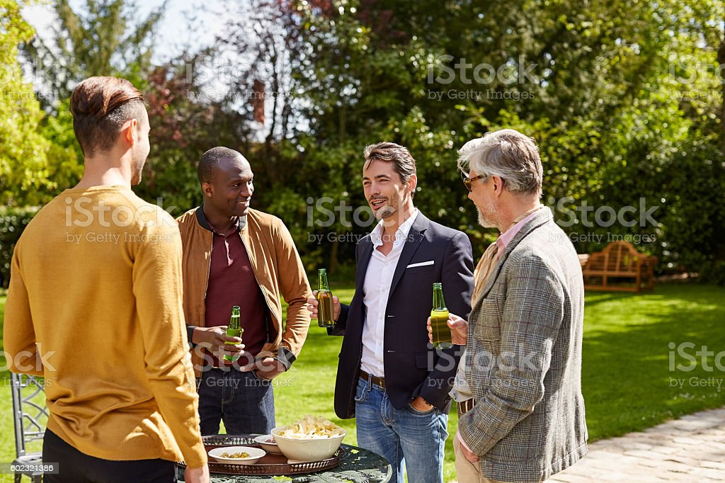 Conversation and drinks are flowing stock photo
