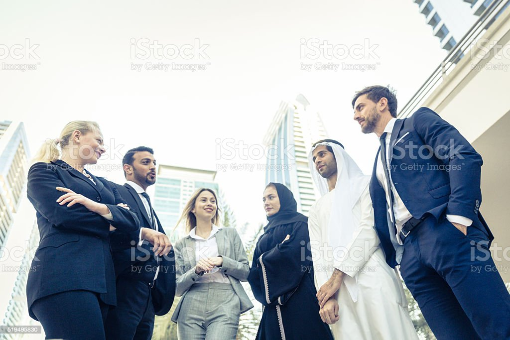 Conversation between multicultural business professional stock photo