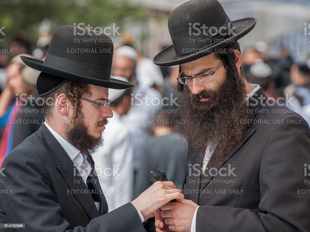 Conversation between two Hasidic Jews. stock photo