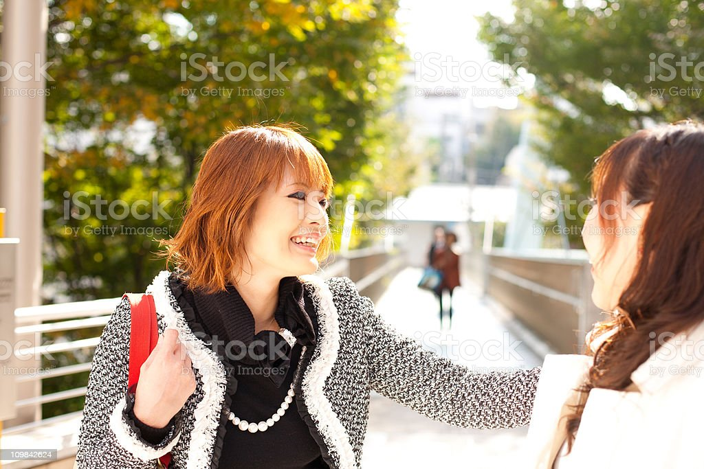 Conversation between two Japanese women royalty-free stock photo