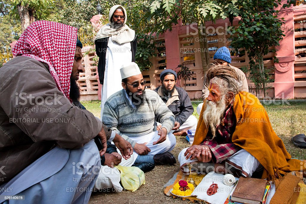 Conversation of the Muslim people with one hindu man stock photo