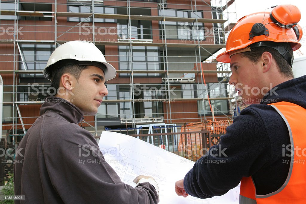 Conversation on construction site royalty-free stock photo