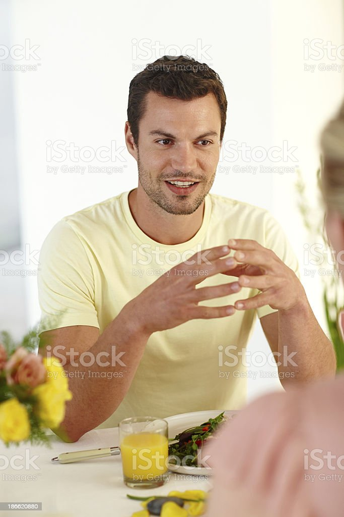 Conversations across the dining table royalty-free stock photo