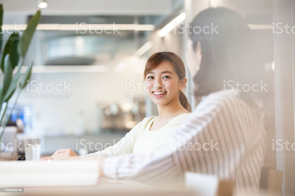 Conversations with women in the Office stock photo