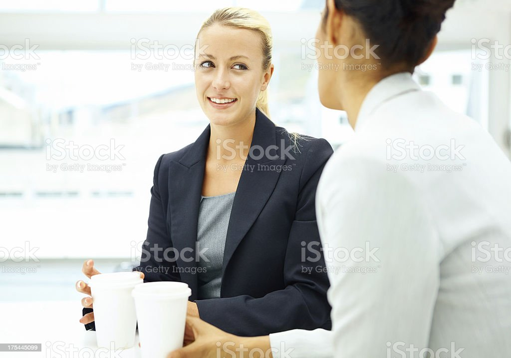 Conversing over coffee - Business People royalty-free stock photo