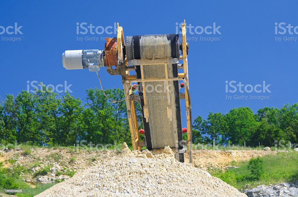 Conveyor belt and crushed rock at a quarry. royalty-free stock photo