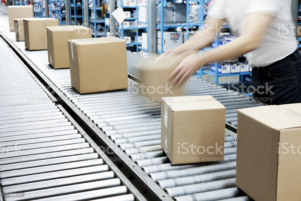 Conveyor Belt and Worker stock photo