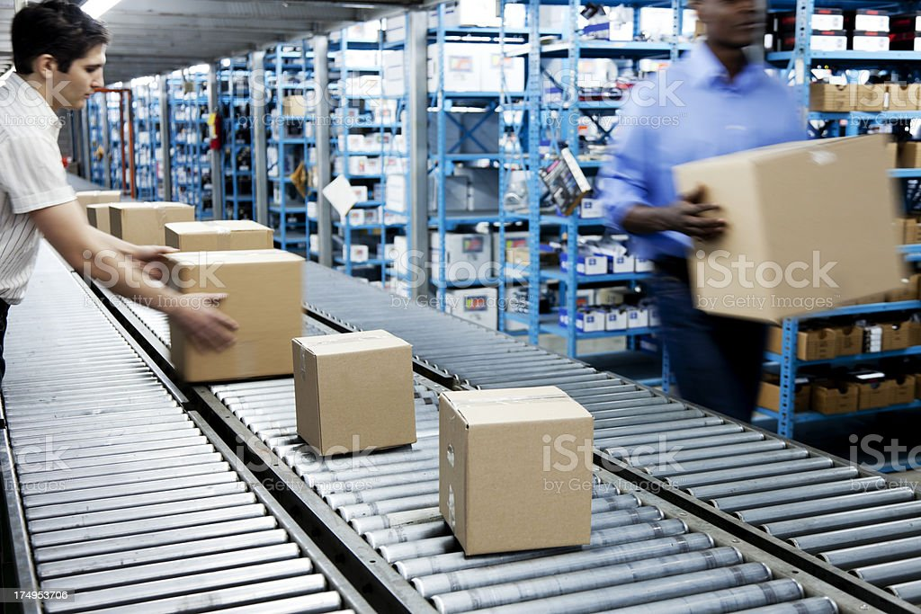 Conveyor Belt and Workers stock photo