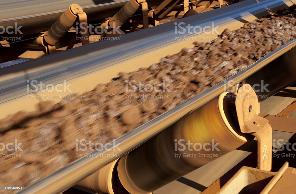 Conveyor belt carrying ore at a minesite. stock photo