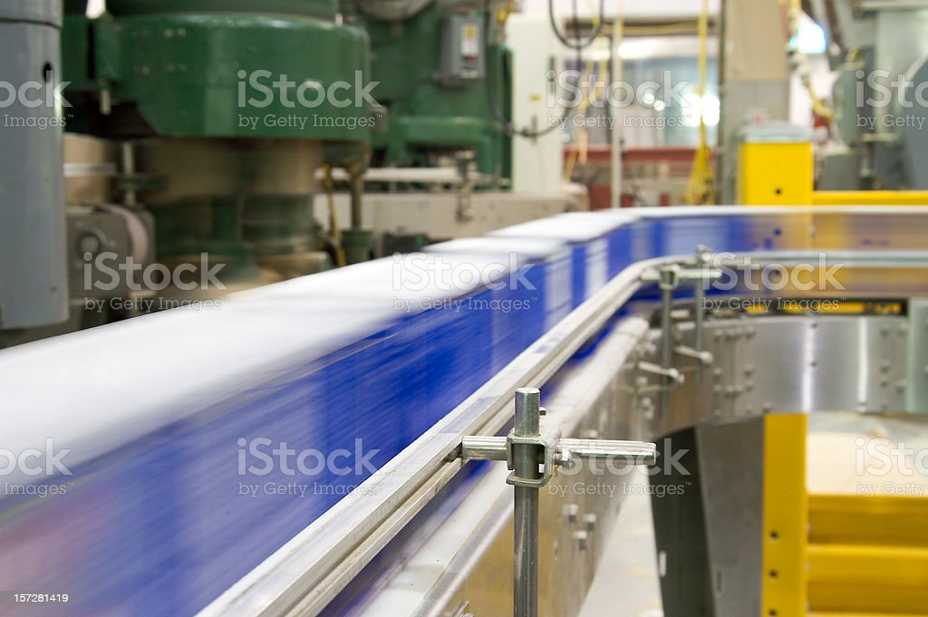 Conveyor belt in a factory in operation stock photo
