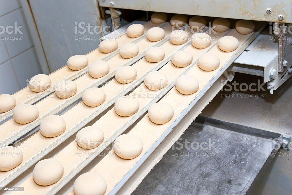 Conveyor Belt of Bun Production stock photo