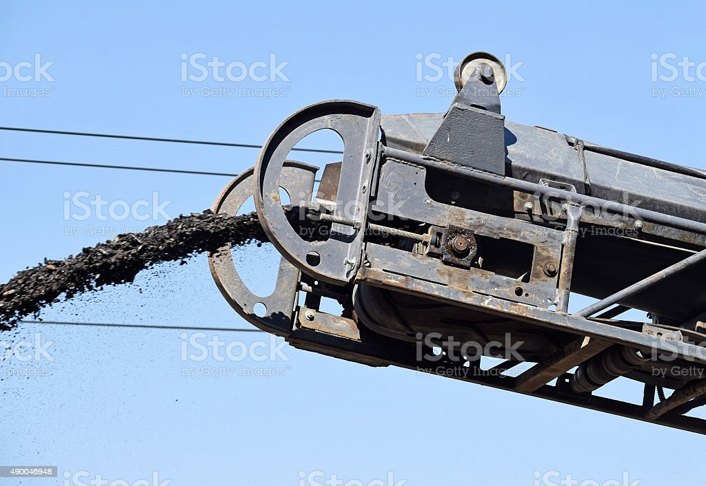 Conveyor belt of the road scraper machinery stock photo