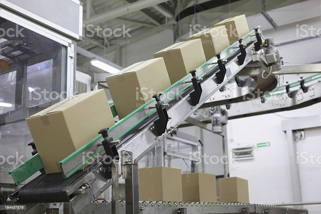conveyor belt with cardboard boxes stock photo