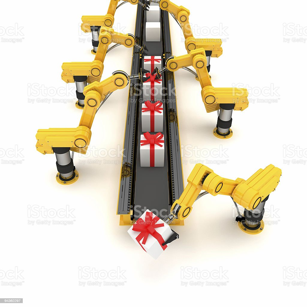 Conveyor belt with tiny white wrapped gift boxes stock photo