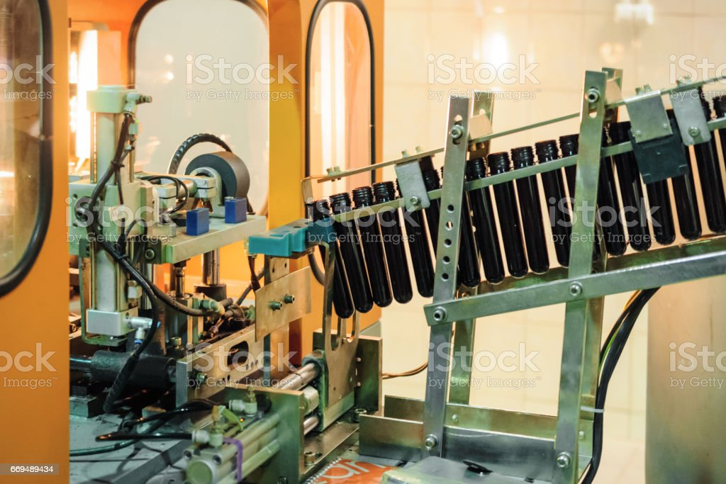 Conveyor for preforms blowing machine stock photo