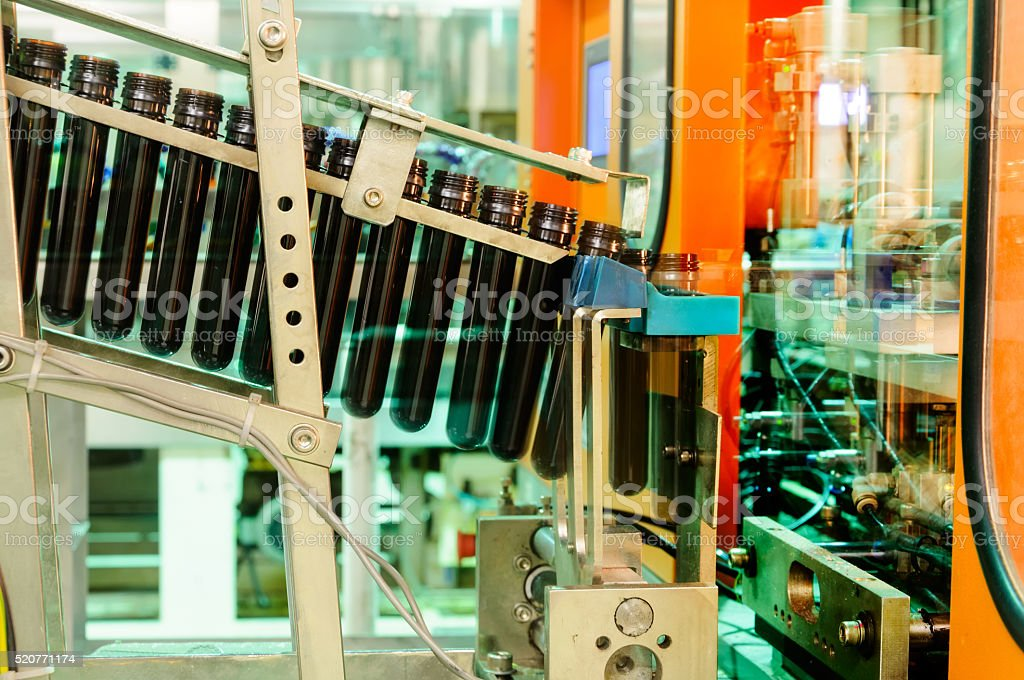 Conveyor for preforms to machine  production of plastic bottles stock photo
