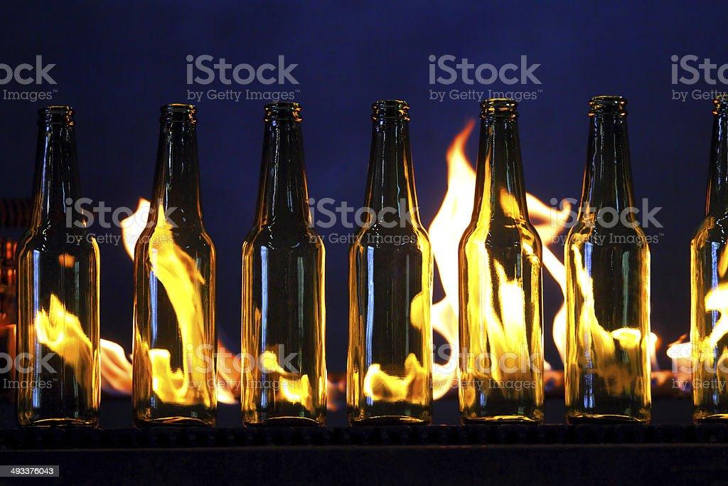 Conveyor line of bottles stock photo