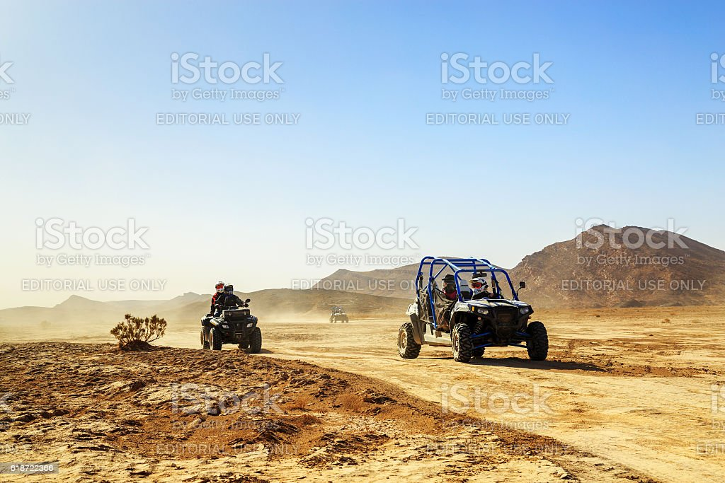 convoy of off-road vehicles in Morocco desert stock photo