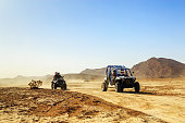 convoy of off-road vehicles in Morocco desert