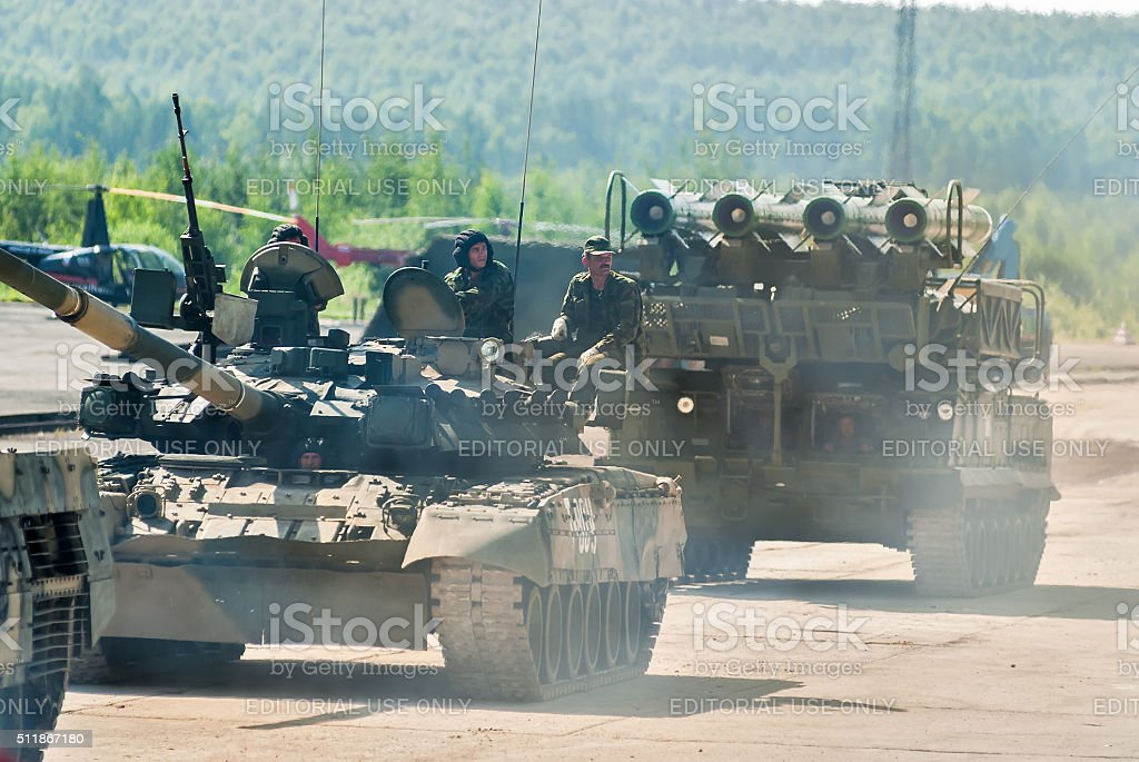 Convoy of T80U tank and Buk-M1-2 in motion stock photo