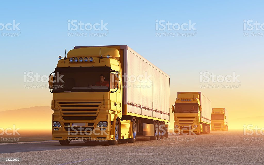 Convoy of yellow trucks on the road stock photo