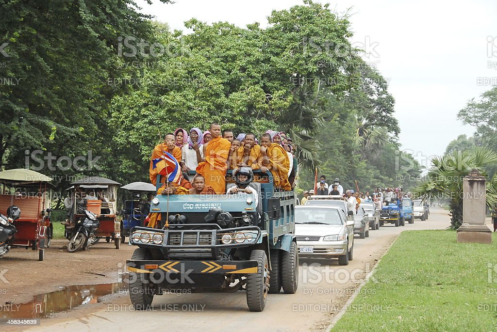 Convoy with Cambodian people go to Water festival. stock photo
