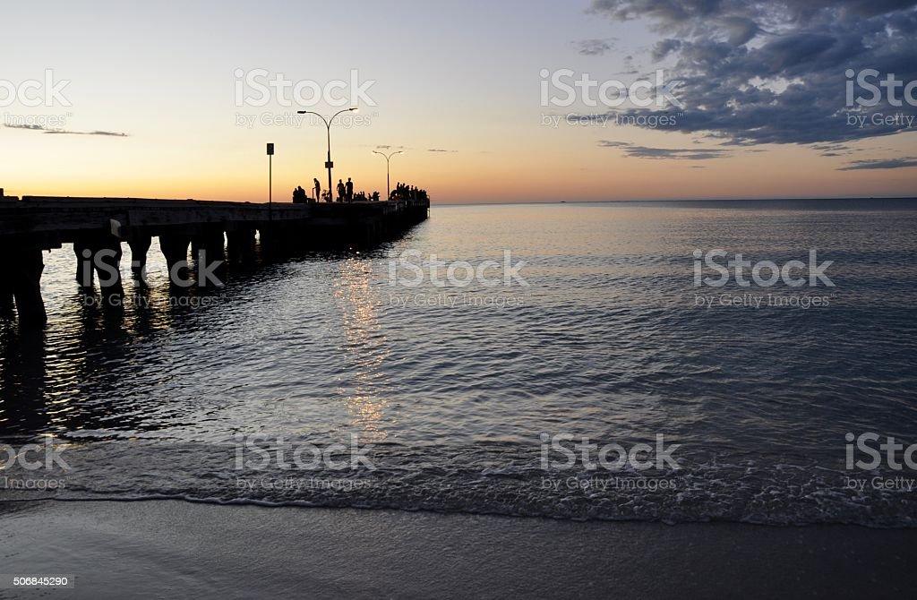 Coogee Beach Jetty: Fishermen Silhouettes stock photo