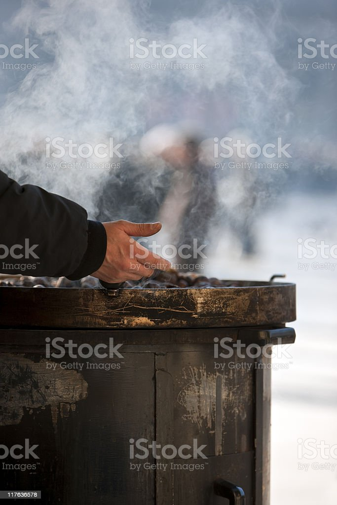 Cook chestnuts. Color Image royalty-free stock photo
