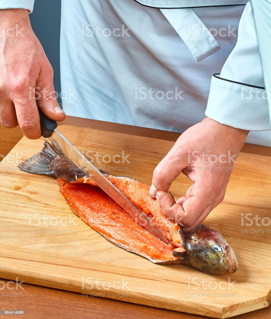 Cook cuts fish full collection of food recipes stock photo