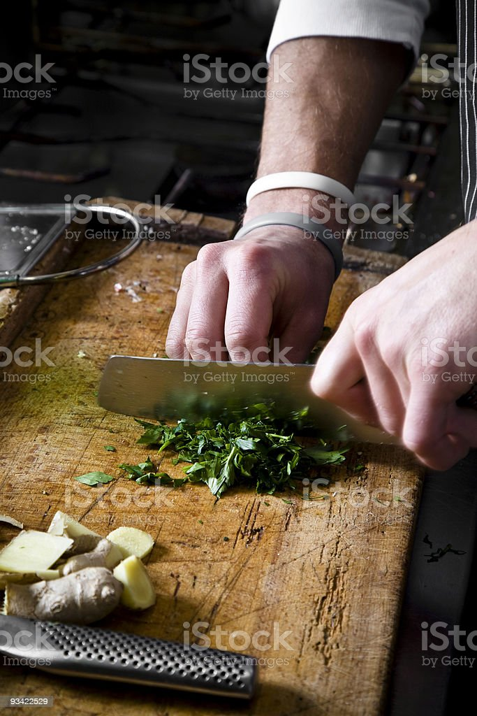 cook cutting herbs stock photo