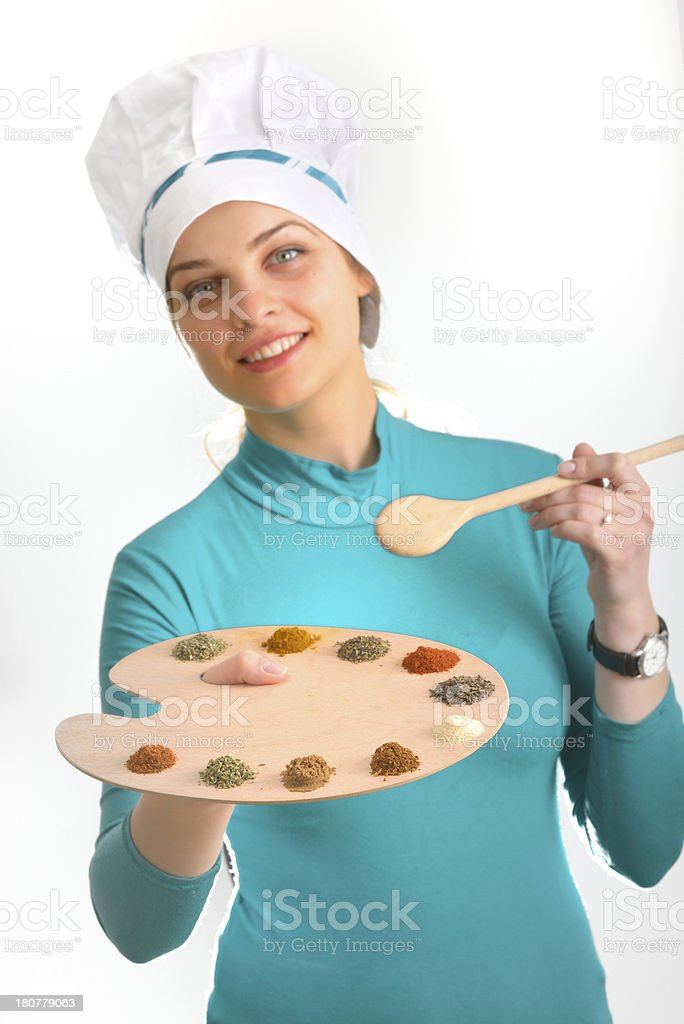 cook girl with spices and herbs on the palette royalty-free stock photo