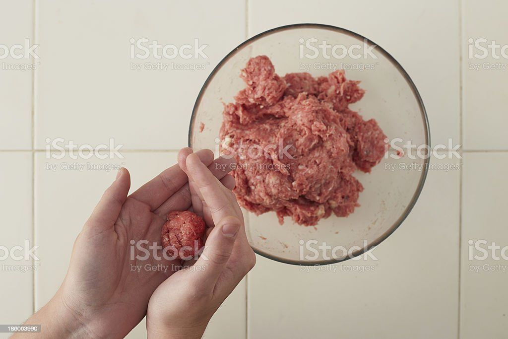 Cook hands making meatballs royalty-free stock photo