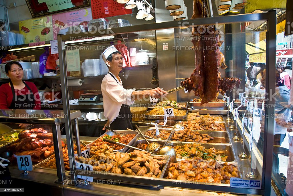 cook in chinese restaurant offers  cookings like duck ,rice, noodles stock photo
